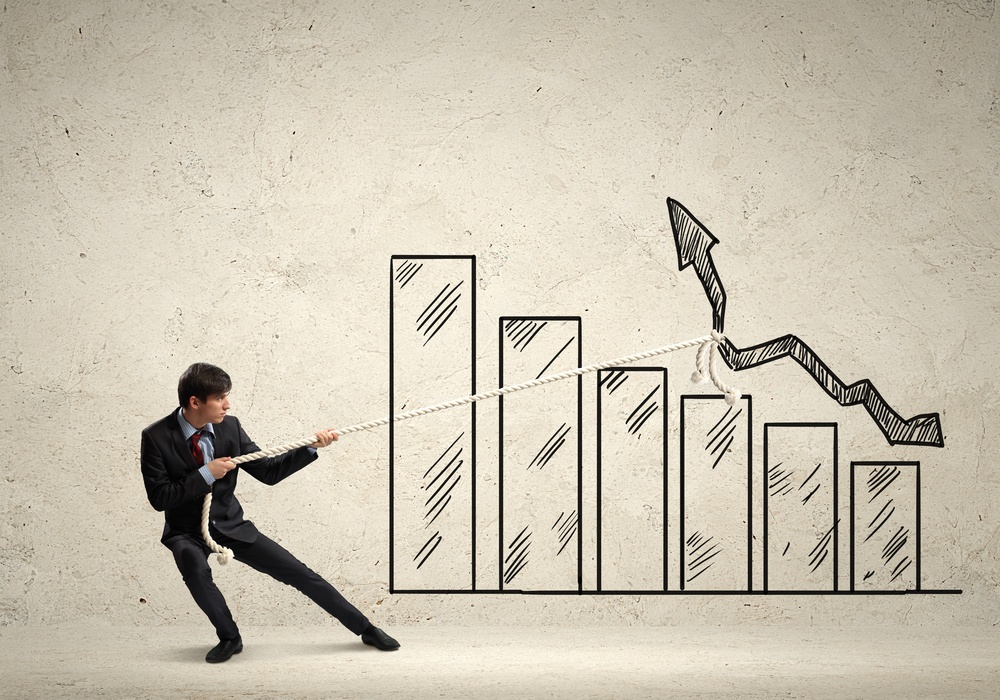 Image of young businessman pulling graph. Chart growth concept.jpeg
