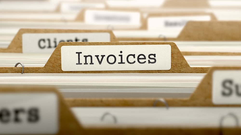 Invoices Concept. Word on Folder Register of Card Index. Selective Focus..jpeg