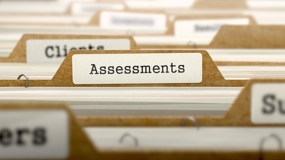 Assessments Concept. Word on Folder Register of Card Index. Selective Focus..jpeg